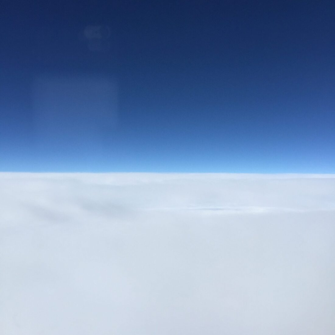 sky and clouds from a plane window